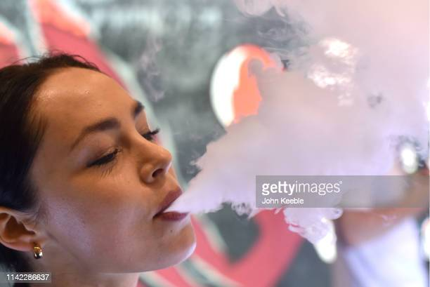 A promotional person vapes during Vape Jam 2019 at ExCel on April 12 2019 in London England Vape Jam UK the premier Electronic Cigarette and ELiquid...