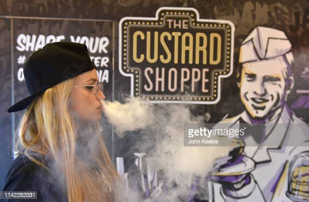 Promotional person vapes on the Custard Shoppe stand during Vape Jam 2019 at ExCel on April 12 2019 in London England Vape Jam UK the premier...