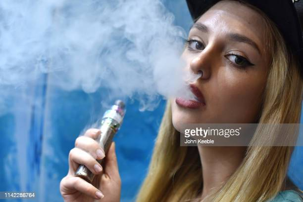 Promotional person Anna Mukonina vapes on the Eliquid France Fruizee stand during Vape Jam 2019 at ExCel on April 12 2019 in London England Vape Jam...