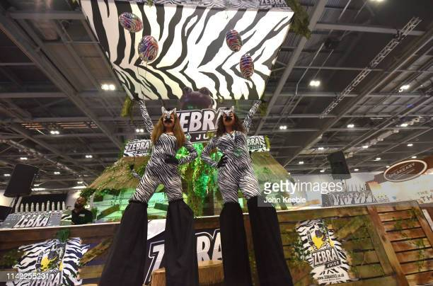 Promotional persons dressed as Zebras pose on the Zebra Juice stand during Vape Jam 2019 at ExCel on April 12 2019 in London England Vape Jam UK the...