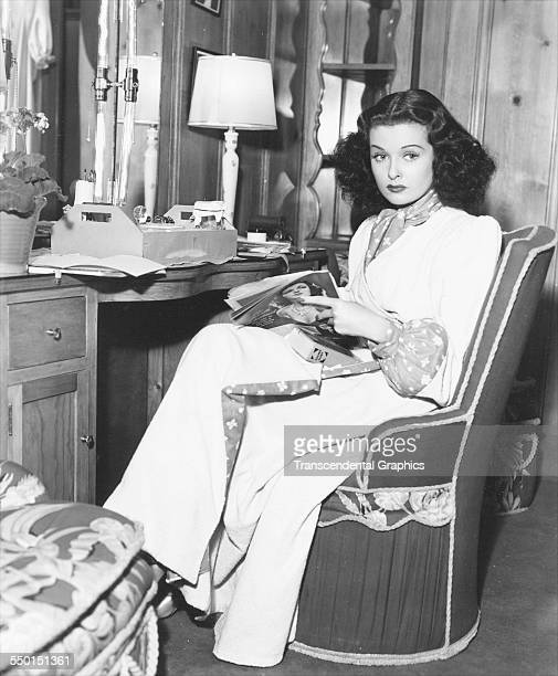 A promotional photo by the Scotty Bjurstrom Agency of actress Joan Bennett in her dressing room Chicago Illinois circa 1950
