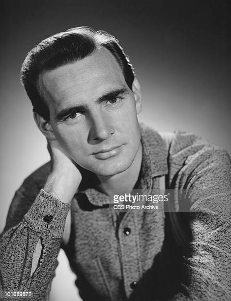 Promotional portrait American actor Dennis Weaver for the longrunning television western series 'Gunsmoke' as he poses with his head on his hand mid...
