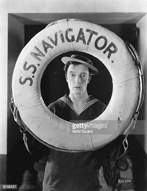 Promotional portrait of actor and director Buster Keaton wearing a sailor suit and holding a life preserver from the film, 'The Navigator,' directed...
