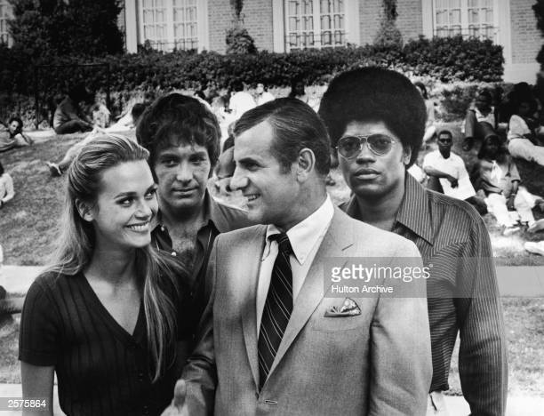 Peggy Lipton Michael Cole Tige Andrews and Clarence Williams III on a university campus for the television series 'The Mod Squad' c 1968