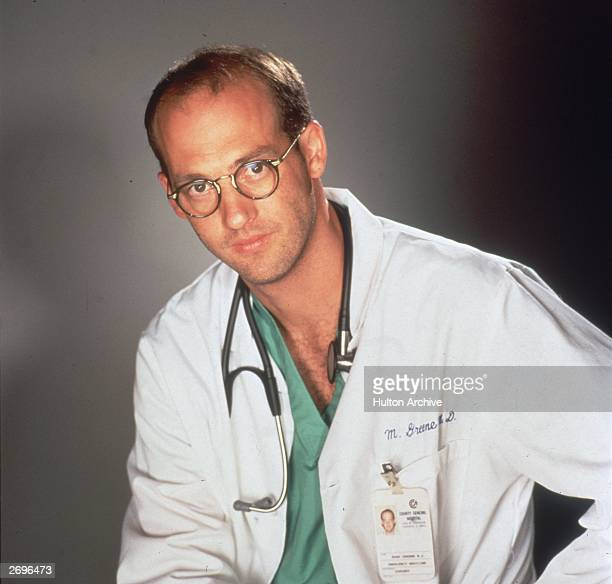 Promotional portrait of American actor Anthony Edwards star of the television series 'ER' dressed as a doctor