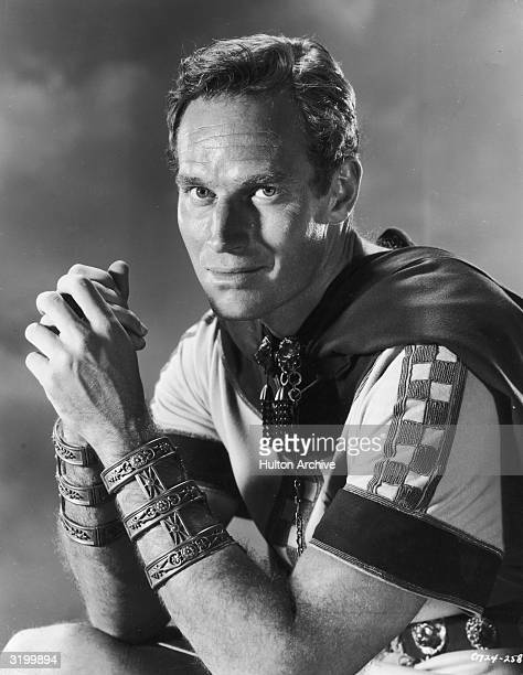 Promotional portrait of American actor Charlton Heston smiling in costume as the title character in director William Wyler's film 'BenHur' He is in...