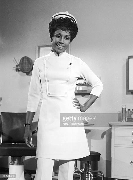 Promotional portrait of American actor Diahann Carroll wearing a nurse's uniform for the television series 'Julia' circa 1968