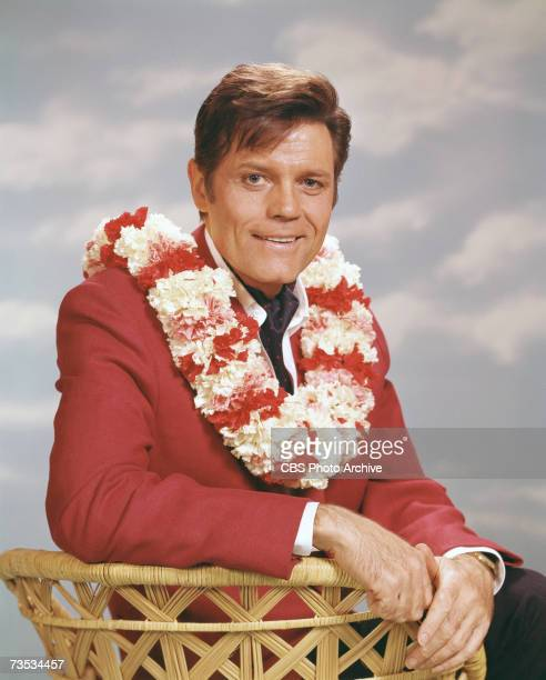 Promotional portrait of American actor Jack Lord born John Joseph Patrick Ryan from the television police crime drama 'Hawaii FiveO' 1979 He sits in...