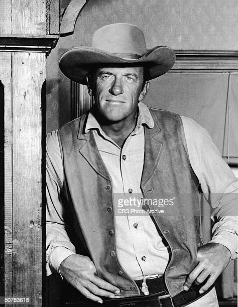 Promotional portrait of American actor James Arness in costume from the Western television series 'Gunsmoke' 1950s