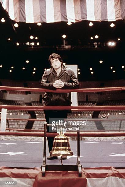 Promotional portrait of American actor Sylvester Stallone as Rocky Balboa standing in a boxing ring from the film 'Rocky' directed by John G Avildsen...