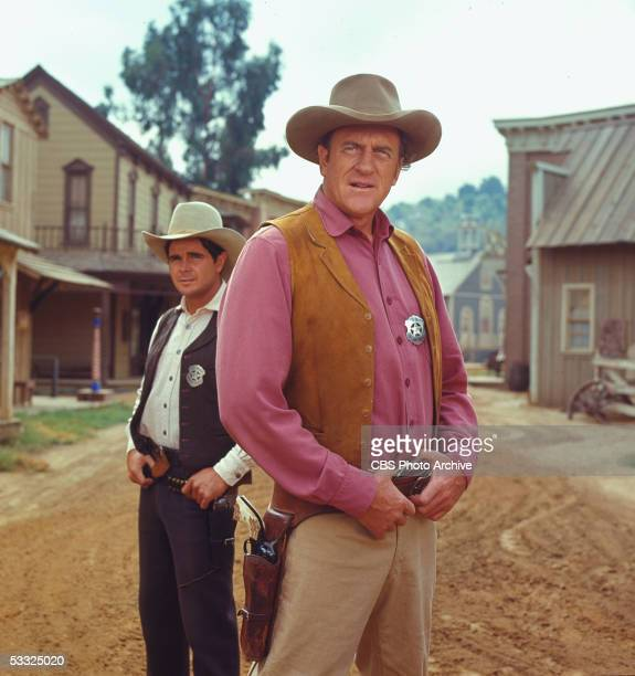 Promotional portrait of American actors James Arness as U S Marshal Matt Dillon0 and Buck Taylor from the television series 'Gunsmoke' 1970
