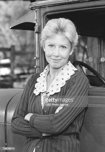 Promotional portrait of American actress Michael Learned as she leans arms crossed against a truck in an episode of the television family drama...
