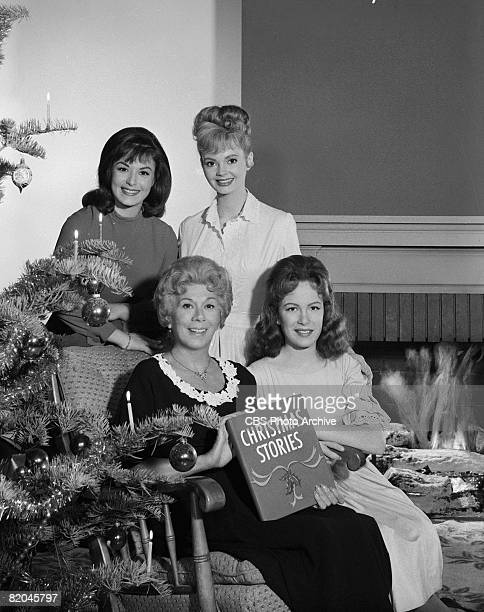Promotional portrait of American actresses clockwise from top left Pat Woodell Jeannine Riley Linda Henning and Bea Benaderet who holds a book of...