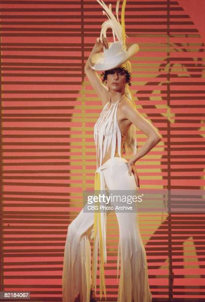 Promotional portrait of American singer and actress Cher dressed in fringed outfit for the television variety show 'The Sonny and Cher Comedy Hour'...