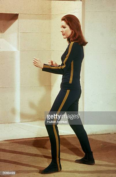 Promotional portrait of British actor Diana Rigg, as Emma Peel, posed in a fight stance for the television program, 'The Avengers,' circa 1966.