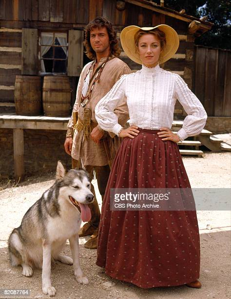 Promotional portrait of British actress Jane Seymour as Dr Michaela 'Mike' Quinn and American actor Joe Lando as Byron Sully along with a dog in the...