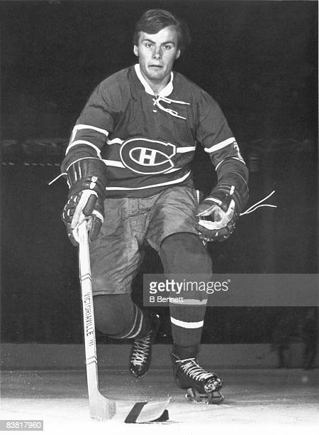 Promotional portrait of Canadian ice hockey player Marc Tardif of the Montreal Canadiens as he skates with the puck early 1970s