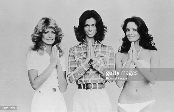 Promotional portrait of from left American actresses Farrah Fawcett Kate Jackson and Jaclyn Smith as they pose with palms together for the television...