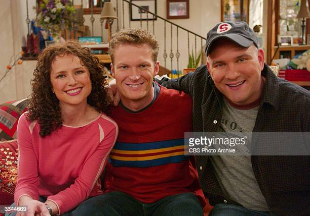 Promotional portrait of guest star American NASCAR race car driver Dale Earnhardt Jr with actors Jean Louisa Kelly and Mike O'Malley on the set of...