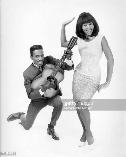 Promotional portrait of Husband-and-wife R&B duo, Ike & Tina Turner. Ike is holding an acoustic guitar.