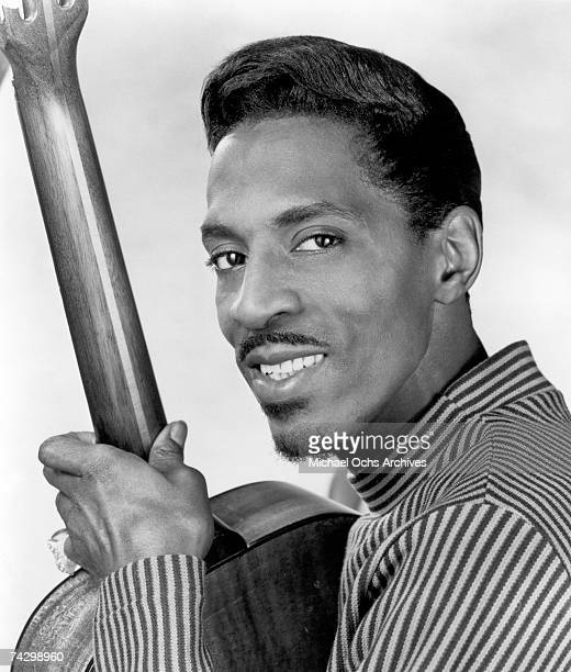 Promotional portrait of Ike Turner holding an acoustic guitar. Master ID: 74298950