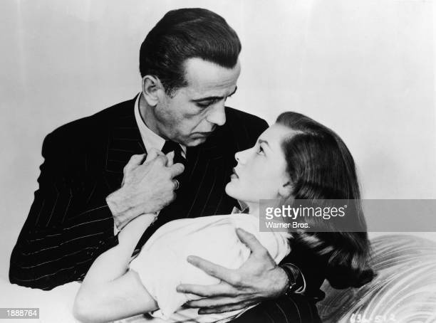 Promotional portrait of married American actors Humphrey Bogart and Lauren Bacall embracing for the film 'The Big Sleep' directed by Howard Hawks 1946