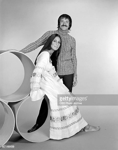 Promotional portrait of married American singing and acting duo Cher and Sonny Bono as they pose together on set early 1970s