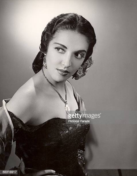 Promotional portrait of Mexican actress Katy Jurado in 'High Noon' directed by Fred Zinnemann as she stands with her hands on her hips and looks over...