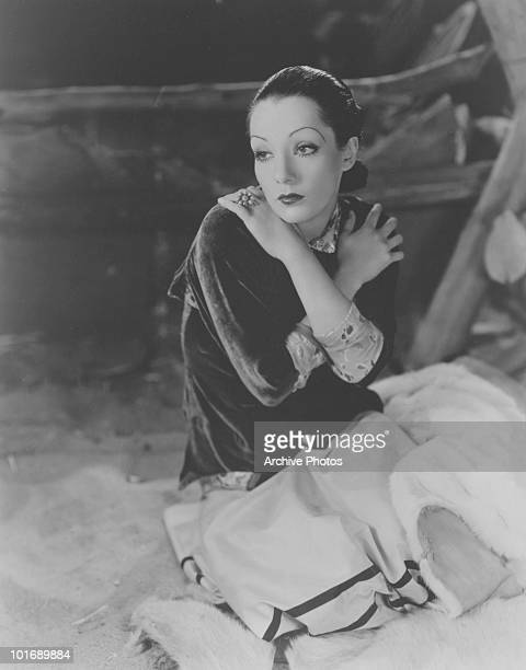 Promotional portrait of Mexican actress Lupe Velez nicknamed the 'Mexican Spitfire' as she poses with her arms crossed over her shoulders early 1940s