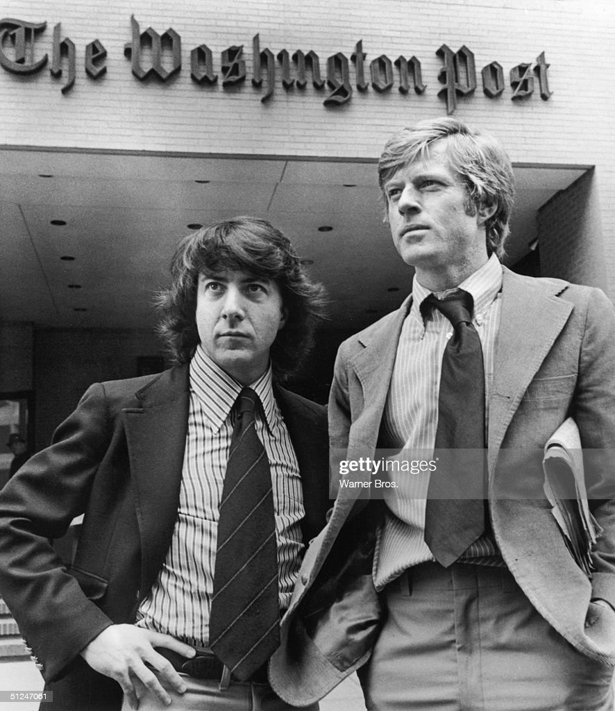 1976, Promotional portrait of Robert Redford, right, and Dustin Hoffman standing in front of the Washington Post Building in a still from director Alan J Pakula's film 'All the President's Men'. The actors portrayed Post reporters Bob Woodward and Carl Bernstein, who were the first to investigate the Watergate scandal.