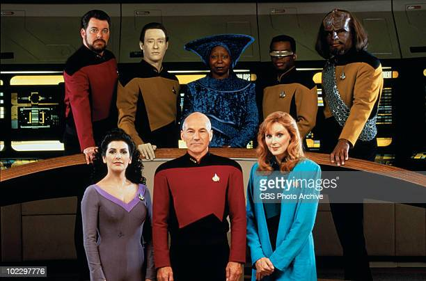 Promotional portrait of the cast of 'Star Trek: The Next Generation,' California, 1987. Pictured are from left, front row, British-American actress...