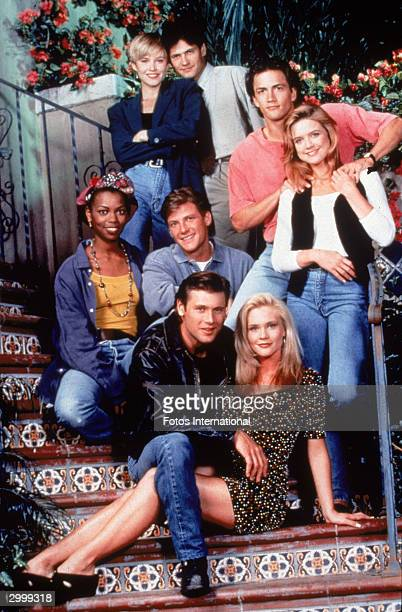 Promotional portrait of the cast of the TV series 'Melrose Place' posing on steps circa 1993 CW LR Josie Bissett Thomas Calabro Andrew Shue Courtney...