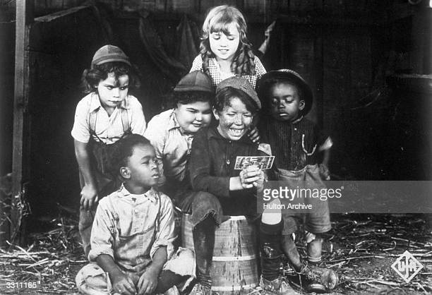A promotional portrait of the child cast of the Hal Roach 'Our Gang' film series circa 1923 Left to right Jackie Condon Eugene 'Pineapple' Jackson...