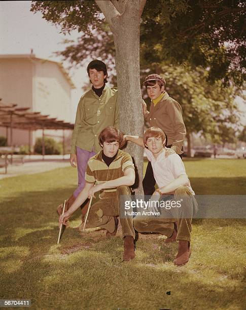Promotional portrait of the Monkees as they pose under a tree late 1960s From clockwise rear left Michael Nesmith Davy Jones Peter Tork and Mickey...