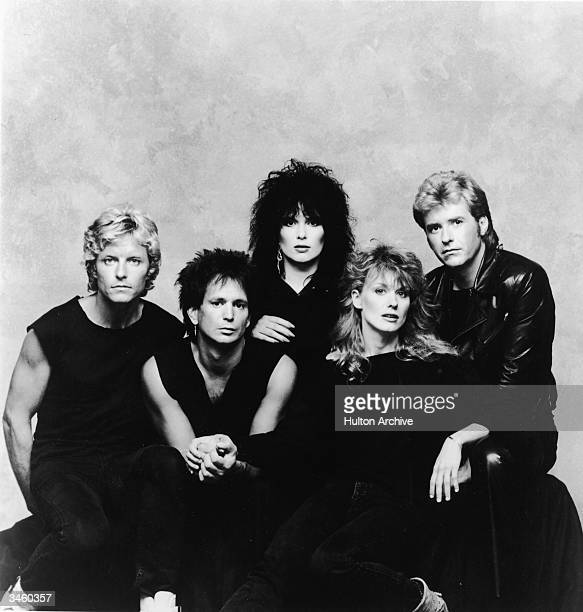 Promotional portrait of the rock group Heart, including: Mark Andes, Denny Carmissi, Ann Wilson, Nancy Wilson and Howard Leese, circa 1980s.