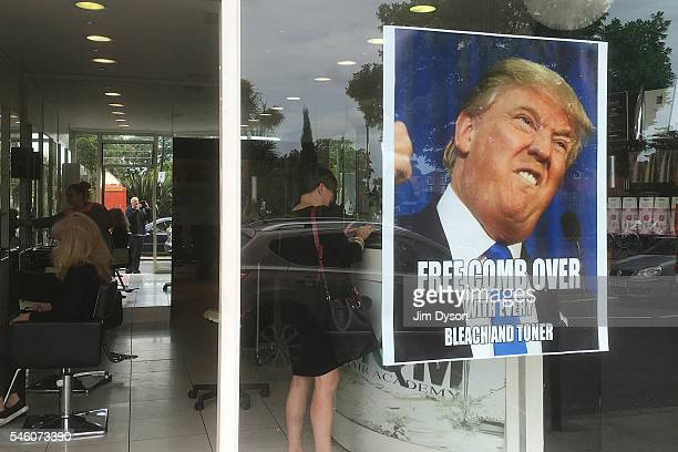 A promotional poster in the window of MM Hair Academy in South Ealing pokes fun at the hairstyle of Republican presidential nominee Donald Trump on...