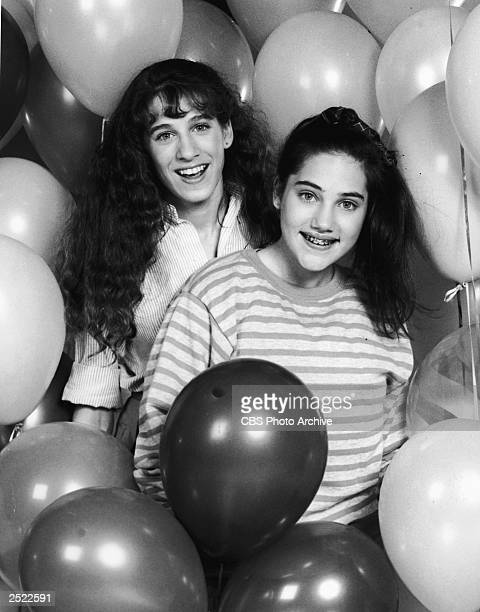 Promotional protrait of Amy Linker and Sarah Jessica Parker amidst balloons for the television series 'Square Pegs' 1982