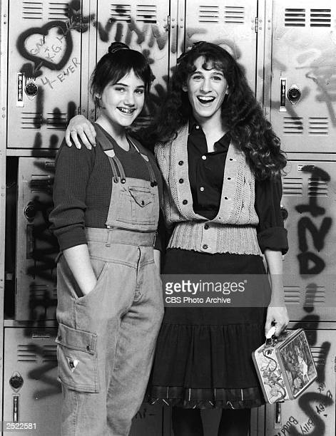 Promotional protrait of Amy Linker and Sarah Jessica Parker in front of graffitti covered high school lockers for the television series 'Square Pegs'...