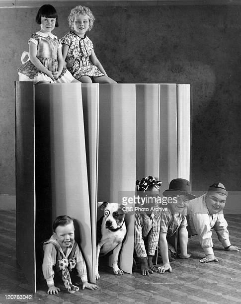 Promotional shot for Our Gang later to be know as The Little Rascals On top of book Mary Ann Jackson Jean Darling On floor from left Bobby 'Wheezer'...