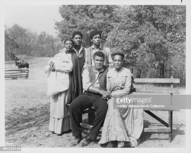 Promotional shot of actor and boxer Muhammad Ali with actress Barbarao Jones as they appear in the movie 'Freedom Road' 1979