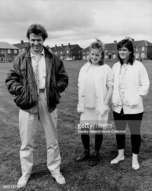 Promotional shot of actors George Costigan, Michelle Holmes and Siobhan Finneran, as they appear in the film 'Rita, Sue and Bob Too!', 1987.
