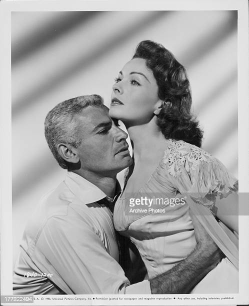 Promotional shot of actors Jeannie Crain and Jeff Chandler as they appear in the movie 'The Tattered Dress' 1957