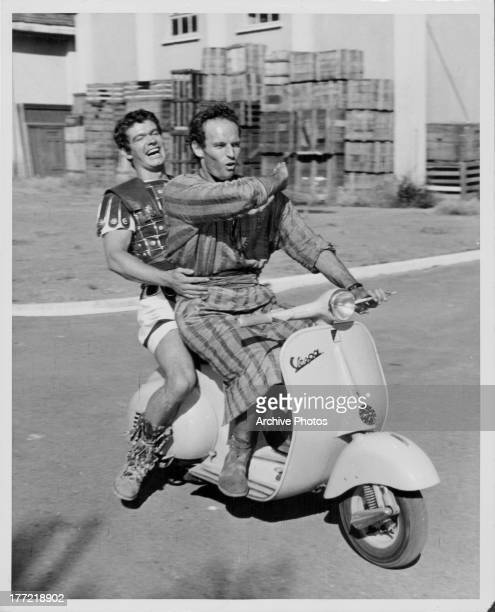 Promotional shot of actors Stephen Boyd and Charlton Heston behind the scenes at Cinecitta Studios in Rome as they appear in the movie 'Ben Hur' 1959