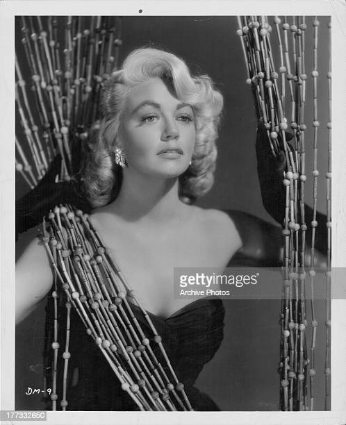 Promotional shot of actress Dorothy Malone as she appears in the movie 'Quantez' 1956