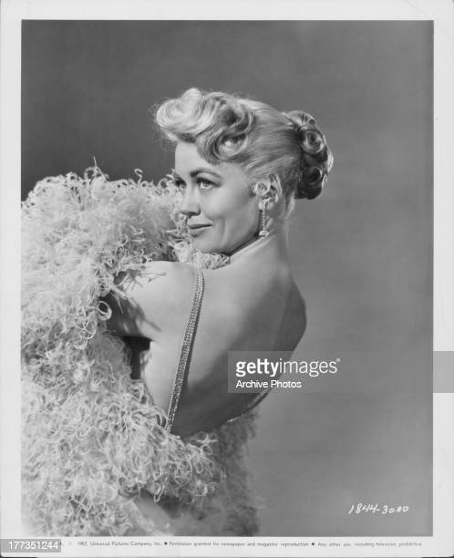 Promotional shot of actress Dorothy Malone posing provocatively following the completion of her new movie 'The Tarnished Angels' 1957