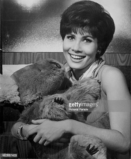 Promotional shot of actress Michele Lee holding a cuddly koala toy circa 1960
