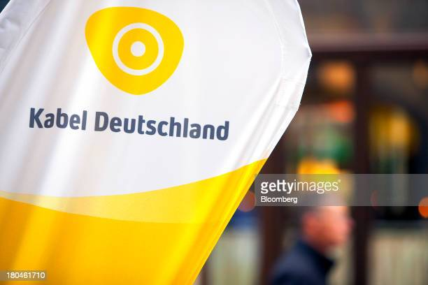 A promotional sign for Kabel Deutschland is seen displayed outside a telecommunication store operated by the company in Leipzig Germany on Thursday...