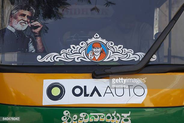 Promotional stickers for ridehailing service Ola owned by ANI Technologies Pvt are displayed on an auto rickshaw in Bengaluru India on Saturday May 7...