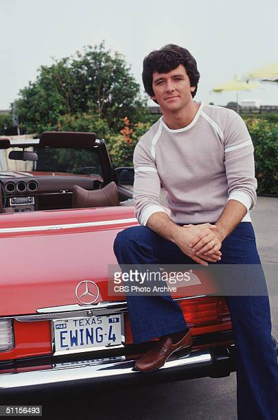A promotional still from the American television series 'Dallas' shows American actor Patrick Duff who plays Bobby Ewing as he sits on the trunk of a...