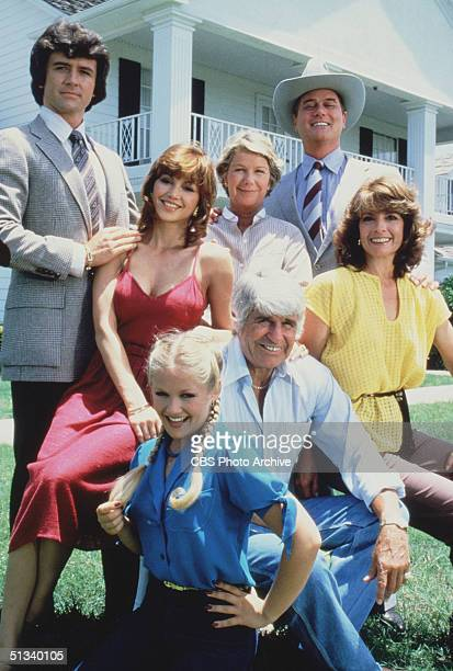 Promotional still from the American television series 'Dallas' shows members of the Ewing family as they pose in front of their television home, the...